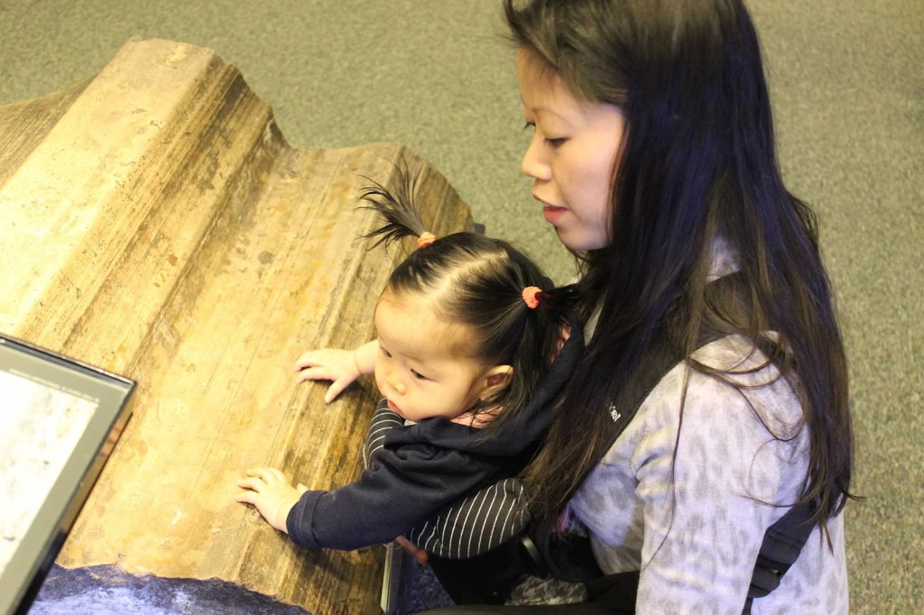 Mother and daughter attend an infant workshop exploring the sense of touch at the National Museum of Natural History