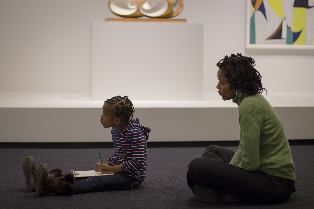 A quiet moment at the Hirshhorn while a child sketches.
